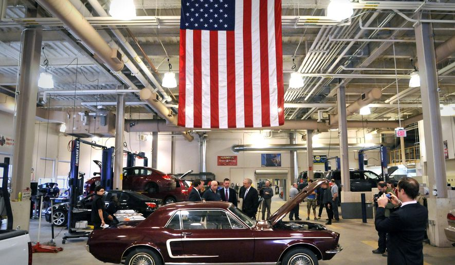 MEMBER FEATURE EXCHANGE ADVANCE FOR WEEKEND OF APRIL 25TH AND 26TH--Visitors gathered at Worcester Technical High School to view a freshly-restored 1967 Ford Mustang on Tuesday, April 7, 2015. Students in the school's Automotive Technology and Automotive Collision programs restored the vintage car, which will be raffled off in May to benefit the school's Skyline Fund. (Paul Kapteyn, The Worcester Telegram & Gazette via AP)