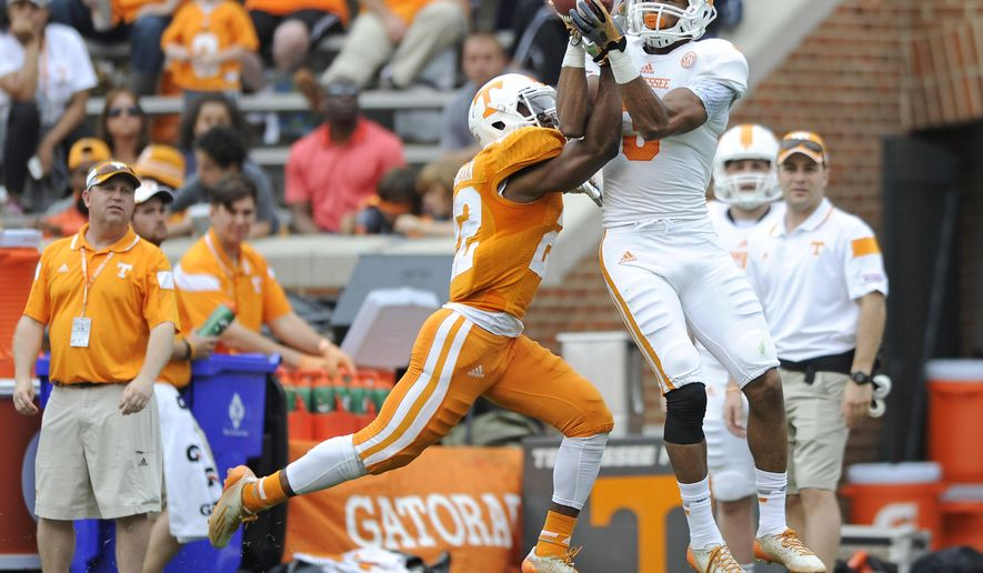 Tennessee defensive back Malik Foreman (22) breaks up a pass intended for wide receiver Josh Malone (3) during the NCAA college football team's Orange & White game at Neyland Stadium on Saturday, April 25, 2015, in Knoxville, Tenn. (Adam Lau/Knoxville News Sentinel via AP)