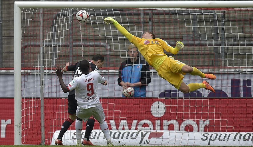 Leverkusen's goalkeeper Bernd Leno saves a ball during the German first division Bundesliga soccer match between 1. FC Cologne and Bayer Leverkusen in Cologne, Germany, Saturday, April 25, 2015. (AP Photo/Martin Meissner)