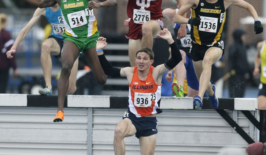 Illinois' Dylan Lafond comes out of the water pit during the men's 3,000-meter steeplechase race at the Drake Relays athletics meet, Saturday, April 25, 2015, in downtown Des Moines, Iowa. LaFond won the event. (AP Photo/Charlie Neibergall)