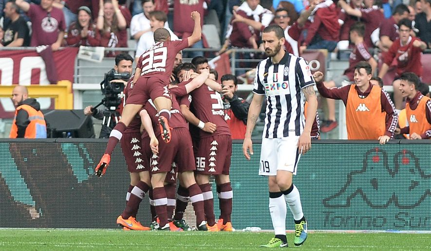 Torino players celebrates after Fabio Quagliarella scored during a Serie A soccer match between Torino and Juventus at the Olympic stadium, in Turin, Italy, Sunday, April 26, 2015. (AP Photo/Massimo Pinca)