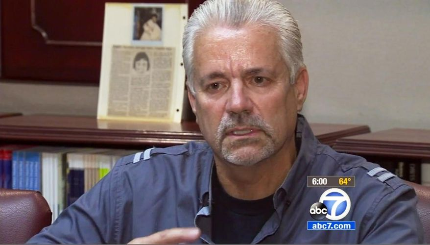 In this April 24, 2015 still from video provided by KABC-TV, retired Santa Ana, Calif., police officer Michael Buelna talks about Robin Barton, now 25, after they are reunited in Santa Ana for the first time since Buelna found Barton as a newborn abandoned in a garbage dumpster. Buelna was on duty on Nov. 21, 1989 when he heard a faint sound coming from a behind a trash bin, sifted through the trash and discovered a baby, his umbilical cord still attached. The child was just four hours old and weighed 4 pounds, 2 ounces. Buelna wanted to adopt him but another Orange County family stepped in first.(KABC-TV via AP)  MANDATORY CREDIT   TV OUT
