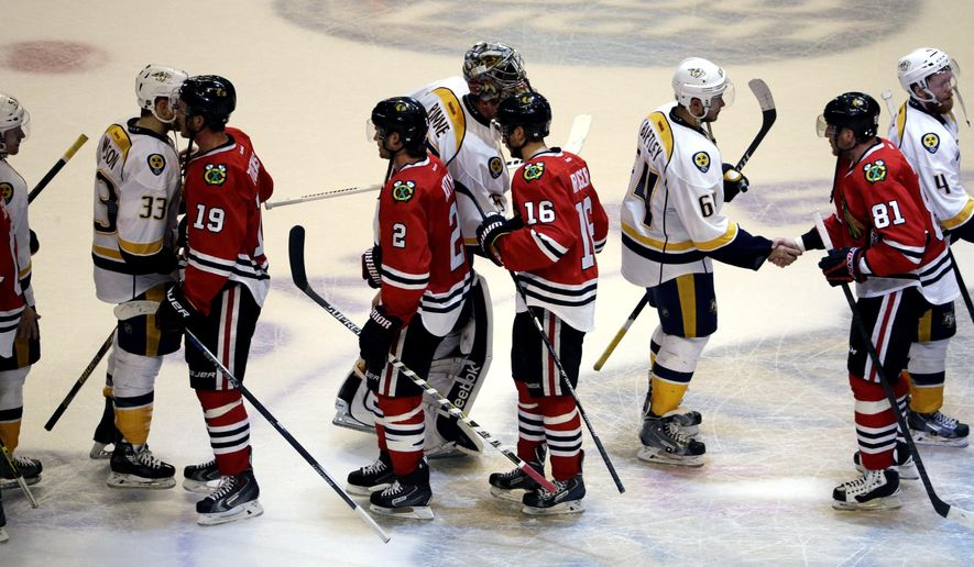 Chicago Blackhawks players shake hands with Nashville Predators after the Blackhawks defeated the Predators 4-3 in Game 6 of an NHL Western Conference hockey playoff series Saturday, April 25, 2015, in Chicago. (AP Photo/Nam Y. Huh)