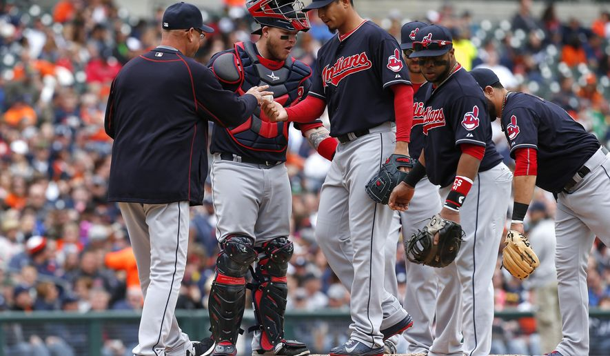 Cleveland Indians manager Terry Francona, left, takes the ball from pitcher Carlos Carrasco in the fifth inning of a baseball game against the Detroit Tigers in Detroit, Sunday, April 26, 2015. (AP Photo/Paul Sancya)