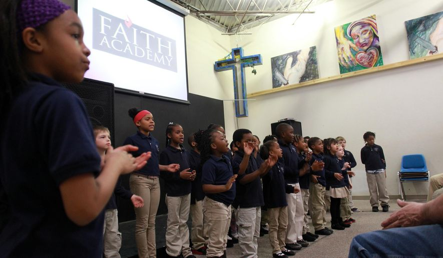 Students at Faith Academy sing to guests at their school on March 31, 2015, in Iowa City, Iowa.  The academy, which is in its second academic year after opening in the fall of 2013, currently has three classes of about 10 students each in kindergarten through second grade.  (David Scrivner/Iowa City Press-Citizen via AP)  NO SALES