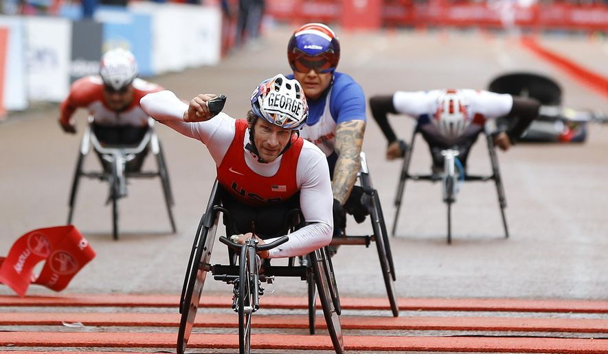 Joshua George of the US wins the Men's Wheelchair Race of the 35th London Marathon, Sunday, April 26, 2015. (AP Photo/Kirsty Wigglesworth)
