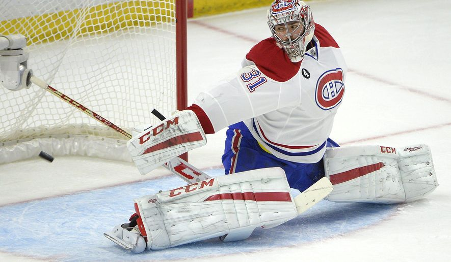 Montreal Canadiens' Carey Price (31) makes a save against Ottawa Senators' Kyle Turris during the first period of Game 6 of a first-round NHL hockey playoff series Sunday April 26, 2015, in Ottawa, Ontario. (Justin Tang/The Canadian Press via AP)   MANDATORY CREDIT