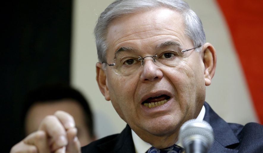 In this Dec. 5, 2014, file photo, Sen. Robert Menendez, D-N.J. speaks in Secaucus, N.J. (AP Photo/Julio Cortez, File)