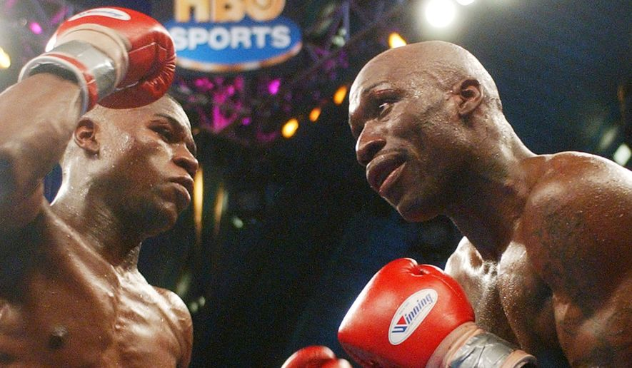 Floyd Mayweather, left, prepares to hit DeMarcus Corley during the 11 round  of the super lightweight eliminator fight at Boardwalk Hall in  Atlantic City, N.J., Saturday, May, 22, 2004.  Mayweather the unanimous decision in 12 rounds over Corely. (AP Photo/ Brian Branch-Price)