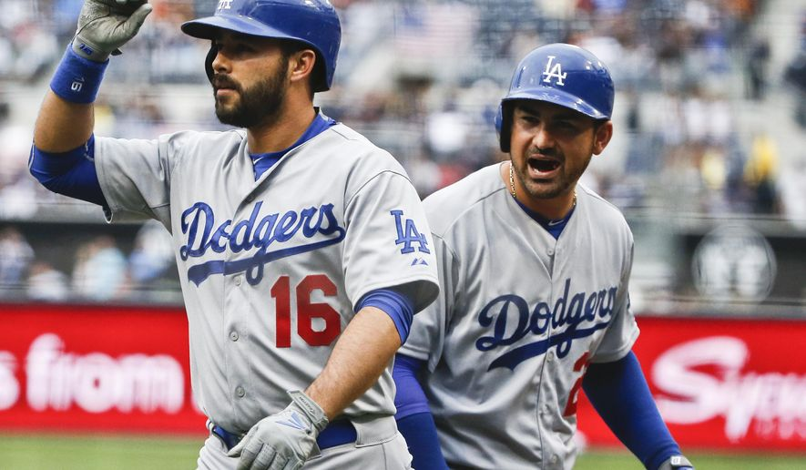 Los Angeles Dodgers' Adrian Gonzalez, right, shouts to teammate Andre Ethier after Either's two-run home run in the first inning of a baseball game against the San Diego Padres, Saturday, April 25, 2015, in San Diego. (AP Photo/Lenny Ignelzi))