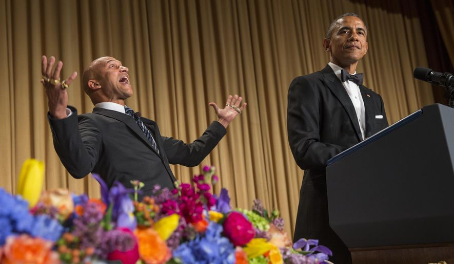 """President Barack Obama, right, brings out actor Keegan-Michael Key from Key & Peele to play the part of """"Luther, President Obama's anger translator"""" during his remarks at the White House Correspondents' Association dinner at the Washington Hilton on Saturday, April 25, 2015, in Washington. (AP Photo/Evan Vucci)"""