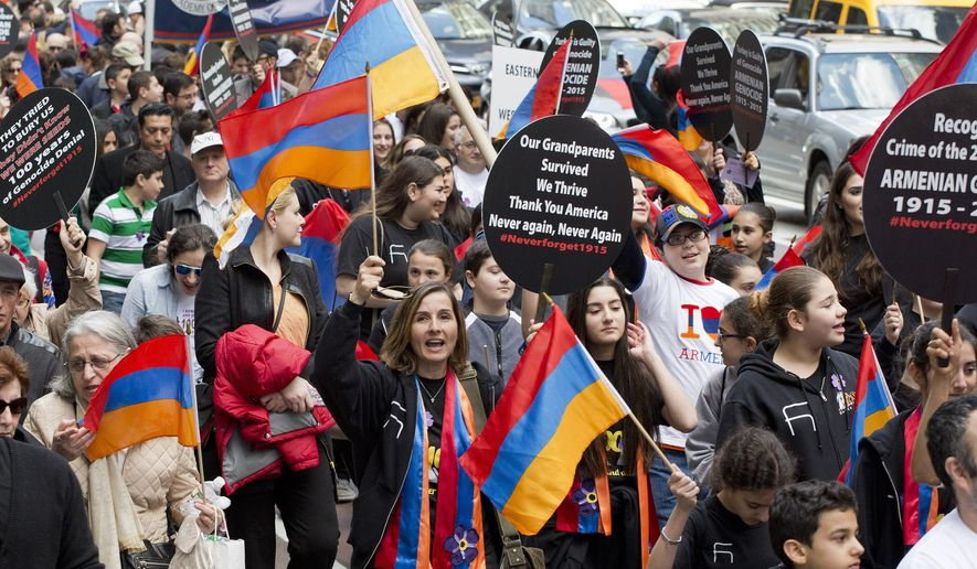 Pro-Armenian activists march in midtown Manhattan in New York to mark the centennial of the killings of as many 1.5 million Armenians under the Ottoman Empire _ today's Turkey _ on Sunday, April 26, 2015. The activists are demanding that the U.S. government acknowledge the deaths during World War I as genocide. (AP Photo/Mark Lennihan)