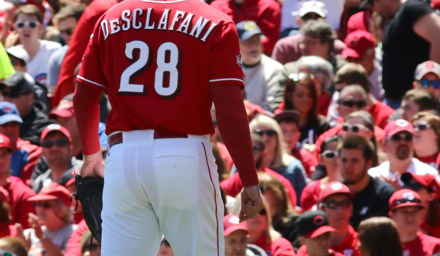 Cincinnati Reds' Anthony DeSclafani walks off the field at the end of the fourth inning in a baseball game against the Chicago Cubs in Cincinnati, Sunday, April 26, 2015. (AP Photo/Tom Uhlman)