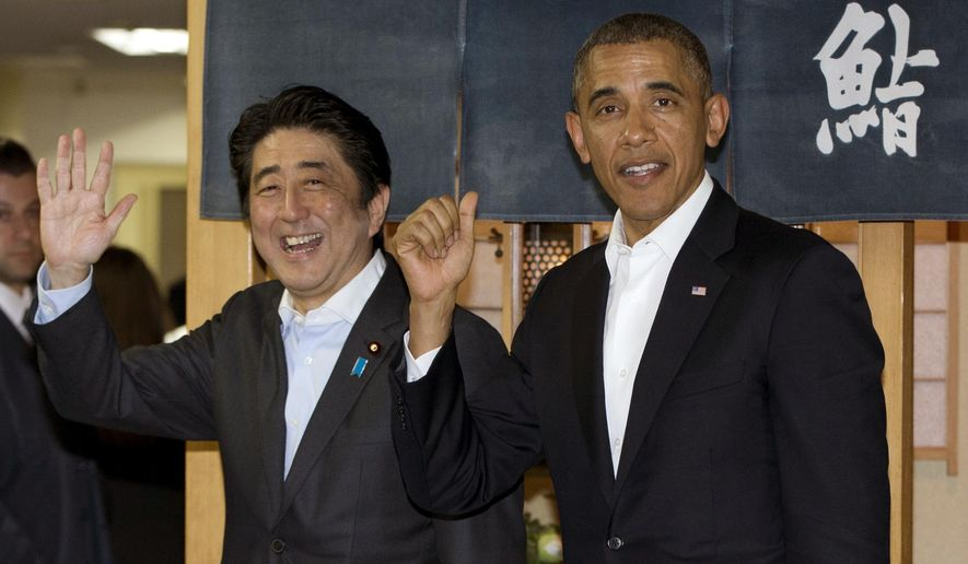 """FILE - In this April 23, 2014 file photo, U.S. President Barack Obama and Japanese Prime Minister Shinzo Abe depart Sukiyabashi Jiro sushi restaurant in Tokyo as Obama opens a four-country swing through the Asia-Pacific region. Abe's itinerary for his eight-day U.S. visit beginning Sunday, April 26, 2015 will showcase the success of the alliance built from Tokyo's defeat in World War II, while promoting a political agenda based on still stronger military and economic ties. Japanese at right in the background reads: """"Sushi."""" (AP Photo/Carolyn Kaster, File)"""