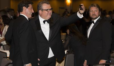 """Modern Family"" actor Eric Stonestreet takes a photo during the White House Correspondents' Association dinner at the Washington Hilton on Saturday, April 25, 2015, in Washington. (AP Photo/Evan Vucci)"
