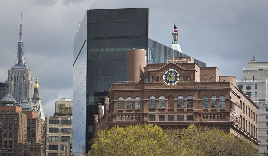 Cooper Union's Foundation Building with its clock tower, one of the tallest in lower Manhattan when it was erected in 1859, rise above tree tops in Cooper Square Park, Thursday, April 23, 2015, in New York. Cooper Union for the Advancement of Science and Art, which produced alumni like Thomas Edison and World Trade Center planner Daniel Libeskind while remaining tuition-free for generations is awaiting the results of a probe that could expose financial mismanagement and tarnish its reputation. (AP Photo/Bebeto Matthews)