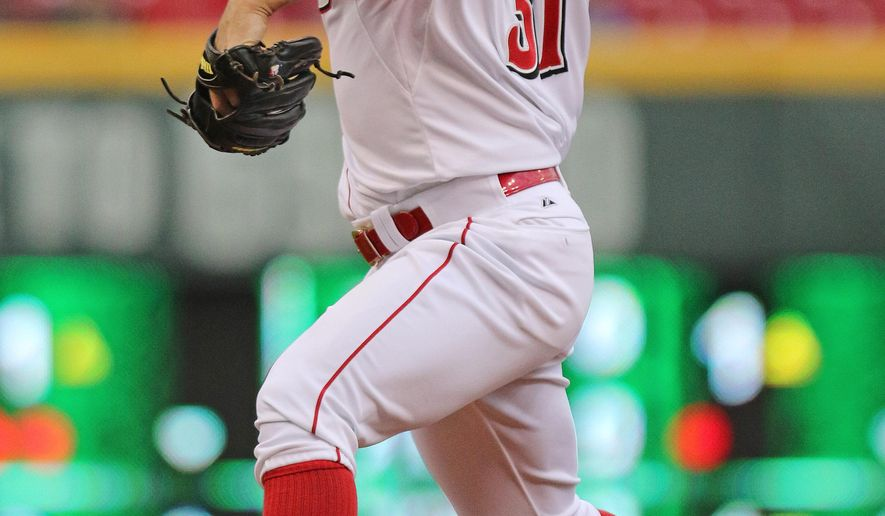 Cincinnati Reds' starting pitcher Jason Marquis (31) throws against the Milwaukee Brewers during the first inning of a baseball game played Monday, April 27, 2015 in Cincinnati. (AP Photo/Gary Landers)
