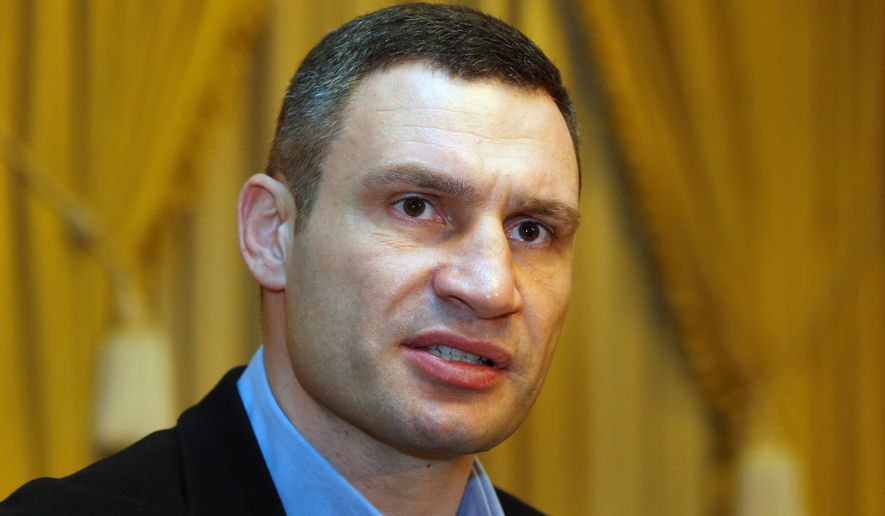 """Using his might: """"If Ukraine will be alone in this fight, it will be a tragedy for all our countries,"""" said Vitali Klitschko, who is pressuring the U.S. and the European Union to help his country keep Western influence. (Associated Press)"""