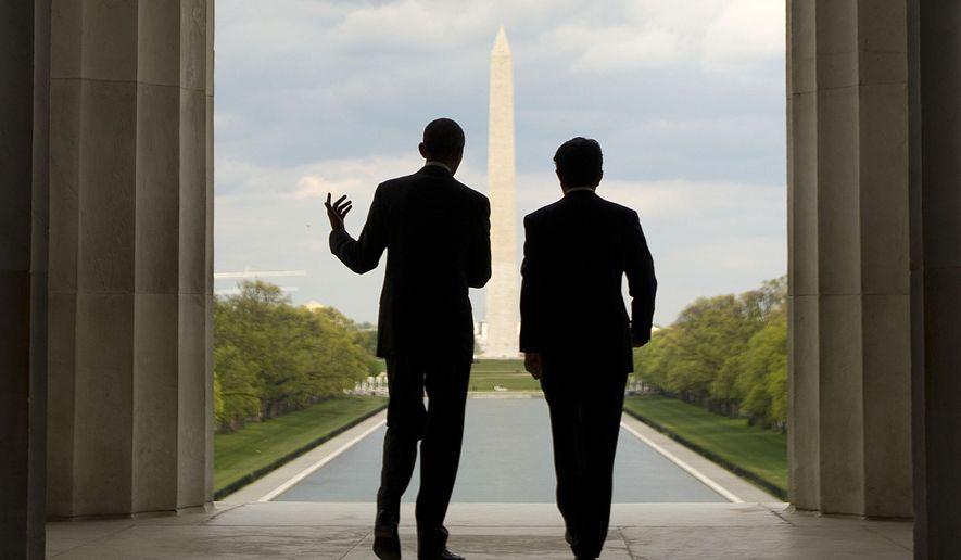 President Barack Obama, left, and Japanese Prime Minister Shinzo Abe visit the Lincoln Memorial, looking toward the Washington Monument, on the National Mall in Washington, Monday, April 27, 2015. (AP Photo/Pablo Martinez Monsivais)