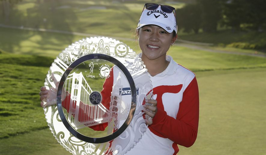 Lydia Ko of New Zealand poses for a photo with her trophy after winning the Swinging Skirts LPGA Classic golf tournament Sunday, April 26, 2015, in Daly City, Calif. Ko won the tournament for the second straight year, beating Morgan Pressel on the second hole of a playoff. (AP Photo/Eric Risberg)