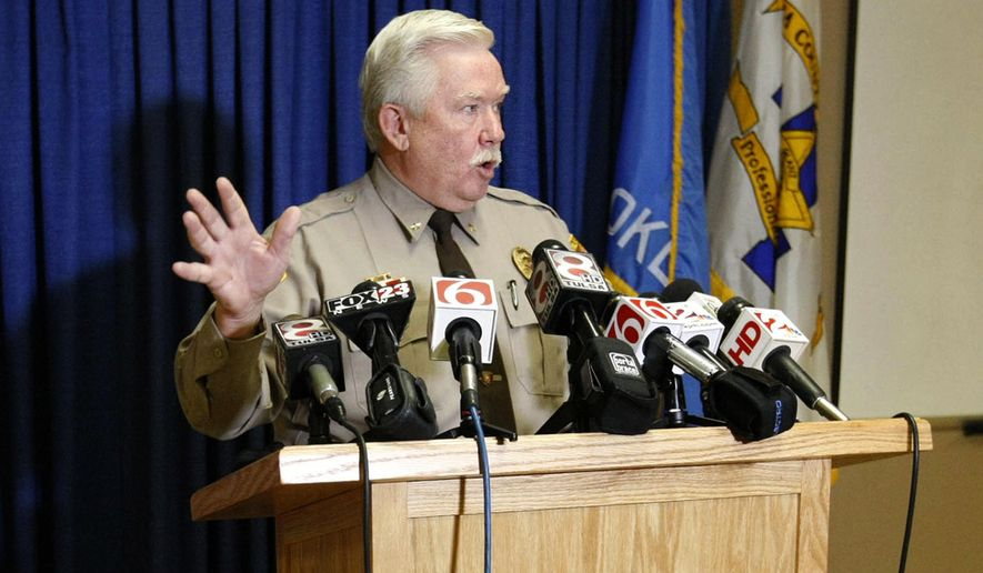 FILE -  In a  Wednesday, Sept. 17, 2014 file photo, Tulsa County Undersheriff Tim Albin briefs reporters on the arrest of former Deputy Gerald Nuckolls, 26, at the agency's headquarters in Tulsa, Okla.  Tulsa County Sheriff Stanley Glanz said in a release Monday, April 27, 2015 that Albin has resigned. Glanz didn't specify why Albin stepped down, but said departmental reorganization was necessary following the shooting by reserve deputy Robert Bates on April 2, 2015.  A memo released on Friday, April 24 indicated Albin quashed criticisms of Bates, who would later go on to fatally shoot a restrained man.(AP Photo/Tulsa World, Matt Barnard, File)  KOTV OUT; KJRH OUT; KTUL OUT; KOKI OUT; KQCW OUT; KDOR OUT; TULSA OUT;