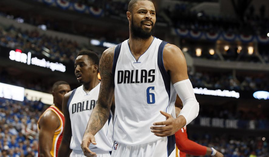 Dallas Mavericks' Tyson Chandler (6) looks toward and official after being charged with a foul against Houston Rockets' Dwight Howard in the first half of Game 4 in an NBA basketball first-round playoff series Sunday, April 26, 2015, in Dallas. (AP Photo/Tony Gutierrez)
