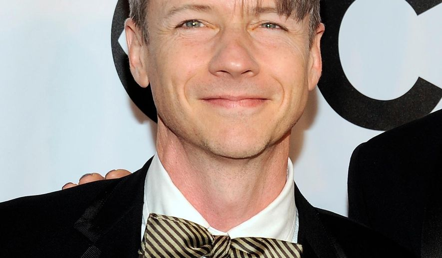 """FILe - In this June 8, 2014 file photo, John Cameron Mitchell arrives at the 68th annual Tony Awards in New York. Mitchell, who co-created the Broadway hit """"Hedwig and the Angry Inch"""" and then played the lead character this spring, will receive the 2015 Special Tony Award. Nominations for the annual awards will be announced on Tuesday. The statuettes will be handed out at Radio City Music Hall on June 7. (Photo by Charles Sykes/Invision/AP, File)"""