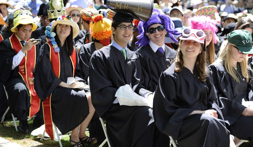 Yale University students wear a variety of head coverings during Class Day at Yale in New Haven (AP Photo/Jessica Hill)