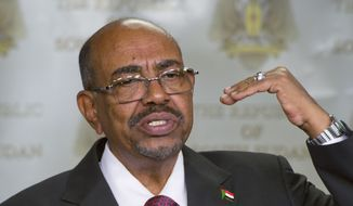 Sudanese President Omar al-Bashir speaks after meeting with South Sudan's President Salva Kiir, in the capital Juba, South Sudan, in this Jan. 6, 2014, file photo. Al-Bashir won re-election with 94 percent of the vote, according to official results announced Monday, April 27, 2015, extending his 25-year rule despite international war crimes charges and multiple insurgencies. (AP Photo/Ali Ngethi, File)