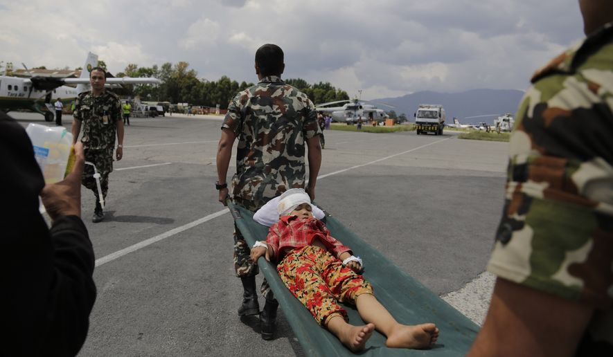 A child injured in Saturday's earthquake, is carried on a stretcher after being evacuated in an Indian Air Force helicopter at the airport in Kathmandu, Nepal, Monday, April 27, 2015. The death toll from Nepal's earthquake is expected to rise depended largely on the condition of vulnerable mountain villages that rescue workers were still struggling to reach two days after the disaster. (AP Photo/Altaf Qadri)