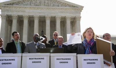 Janet Porter of Faith2Action displays a Restraining Order she pulled from one of sixty boxes of the order while speaking at a Restrain the Judges news conference in front of the Supreme Court in Washington, Monday, April 27, 2015. The opponents of same-sex marriage are urging the court to resist embracing what they see as a radical change in society's view of what constitutes marriage. (AP Photo/Cliff Owen)