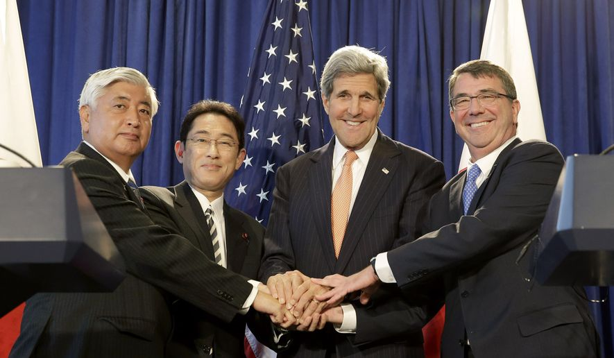 From left, Japanese Defense Minister Gen Nakatani, Japanese Foreign Minister Fumio Kishida, Secretary of State John Kerry, and Defense Secretary of Defense Ash Carter pose for a picture during a news conference in New York, Monday, April 27, 2015. The US and Japan are boosting their defense relationship, allowing Japan to play a bigger role in global military operations with an eye on potential threats from China and North Korea. (AP Photo/Seth Wenig)