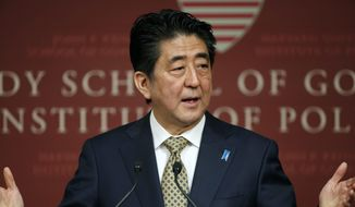 Japanese Prime Minister Shinzo Abe speaks at the John F. Kennedy School of Government forum in Cambridge, Mass., Monday, April 27, 2015. (AP Photo/Michael Dwyer)