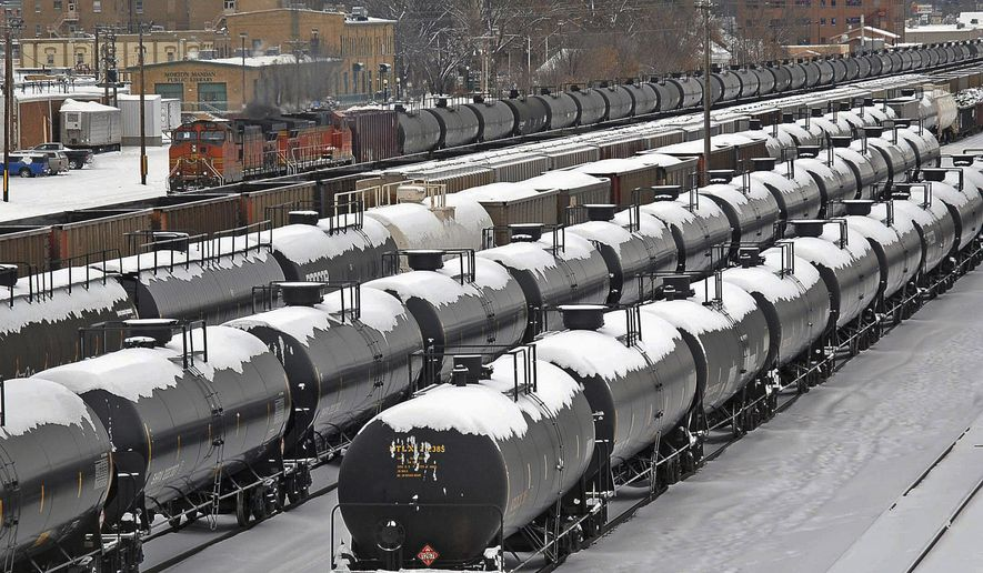 FILE - In this Dec. 31, 2013  file photo, oil cars are backed up in a yard in the aftermath of a train derailment in Mandan, N.D. North Dakota's Senate on Monday, April 27, 2015, approved funding for a state-run rail safety pilot program intended to supplement federal oversight of burgeoning oil train traffic. (Tom Stromme/The Bismarck Tribune via AP, File)