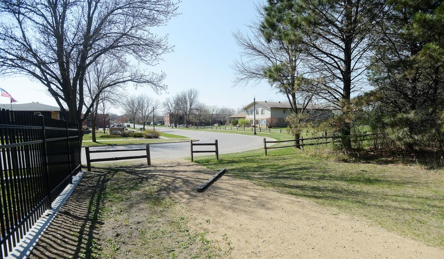 This April 23, 2015 photo shows a path leading through McCrory Gardens and South Dakota Arboretum near Greek Village in Brookings, S.D. The expansion of fraternities and sororities at South Dakota State University could threaten a pristine swath of trees in the South Dakota State Arboretum. (Elisha Page/The Argus Leader via AP) NO SALES