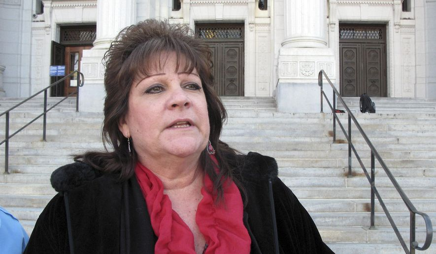 FILE - In this Thursday, Jan. 8, 2015, file photo, Jackie Fortin of Windsor Locks, Conn., speaks outside the Connecticut Supreme Court in Hartford, Conn., shortly after the court ruled the that state child protection officials aren't violating the rights of her 17-year-old daughter by forcing the girl to undergo cancer chemotherapy she doesn't want. Fortin's daughter has finished that treatment and is expected to be released from the hospital, Monday, April 27, 2015. (AP Photo/Pat Eaton-Robb, File)