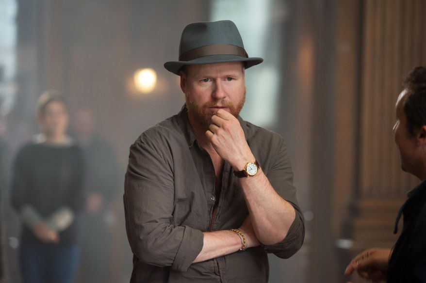 "Director Joss Whedon works on set for the film ""Avengers: Age Of Ultron."" The movie releases in the United States, on May 1, 2015. (Jay Maidment/ Disney/Marvel via AP) ** FILE **"
