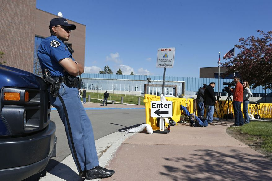 A law enforcement officer keeps watch outside the Arapahoe County Justice Center on the second day of the trial of Aurora movie theater massacre defendant James Holmes, in Centennial, Colo., Tuesday, April 28, 2015. The trial will determine if Holmes will be executed, spend his life in prison or be committed to an institution. (AP Photo/Brennan Linsley)
