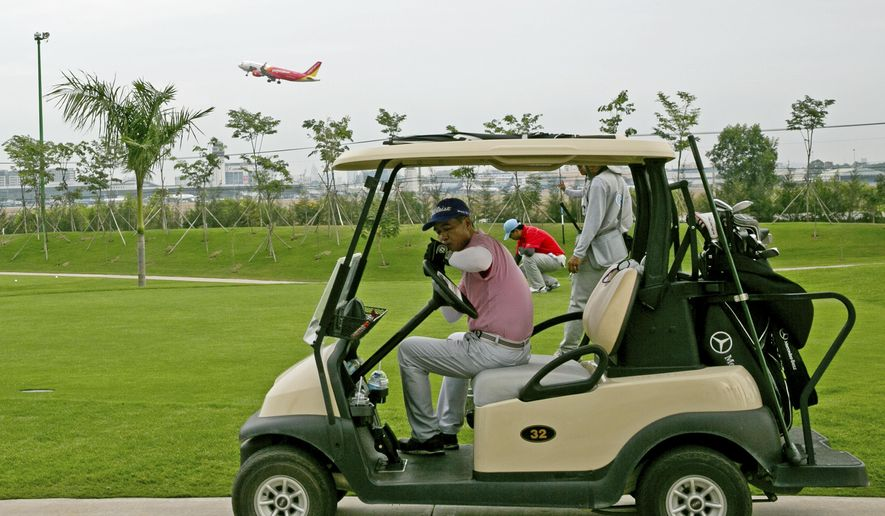 In this photo taken April 13, 2015, a plane takes off from Tan Son Nhat International Airport in Ho Chi Minh City, Vietnam. The airport lies directly beside Tan Son Nhat Golf Course, which sits on military controlled land. Top officials in Vietnam's ruling Communist Party have proposed building a new airport about 40 kilometers (25 miles) away. But some city residents and aviation experts say it makes more sense for the airport to expand precisely where the course lies. (AP Photo/Na Son Nguyen)