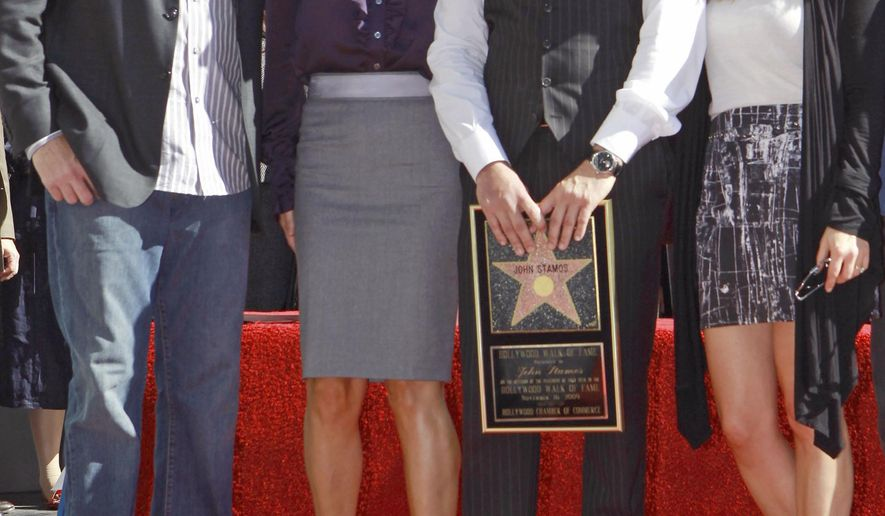 """FILE - In a Monday, Nov. 16, 2009 file photo, actor John Stamos, second right, is joined by former cast members from the family comedy series, """"Full House,"""" Bob Saget, left,  Lori Laughlin, second left,  and Candace Cameron Bure as Stamos is honored with star on the Hollywood Walk of Fame in Los Angeles. Lifetime says it's joining in the 'Full House' revival with a behind-the-scenes movie of the long-running family sitcom.(AP Photo/Damian Dovarganes, File)"""