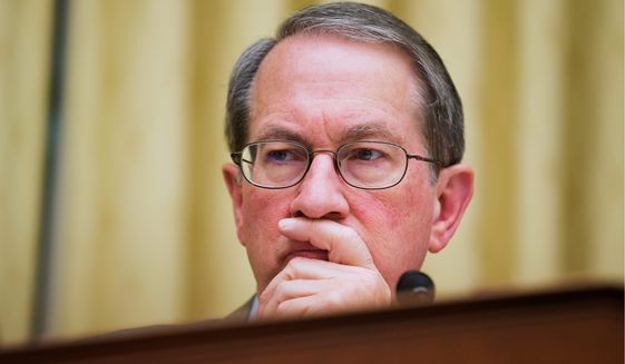 House Judiciary Committee Chairman Rep. Bob Goodlatte, R-Va. listens to the testimony of Attorney General Eric Holder, during the committee's hearing  on the oversight of the Justice Department, Tuesday, April 8, 2014, on Capitol Hill in Washington.  (AP Photo/Manuel Balce Ceneta)