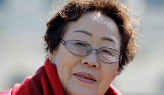 "Yong Soo Lee of South Korea is one of dozens of surviving ""comfort women"" from Korea and other Asian countries who were forced into sexual slavery by the Japanese. (Associated Press)"