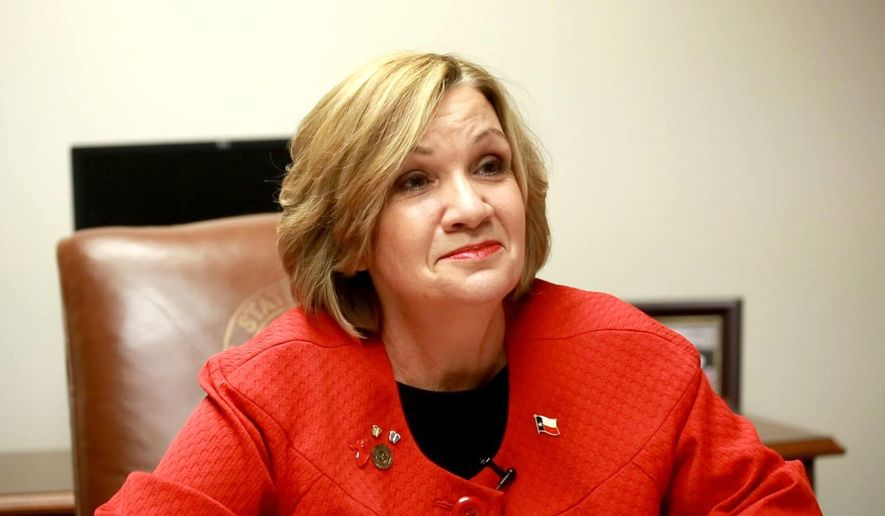 Texas State Rep. Molly White, R-Belton, speaks with a reporter in her office at the Capitol on Wednesday, Feb. 4, 2015 in Austin, Texas. White is part of a bloc of Texas House ultraconservatives who are most aggressively pushing new abortion limits, while Gov. Greg Abbott and other Republican legislative leaders have not prioritized additional restrictions. (Tina Phan/Austin American-Statesman via AP)