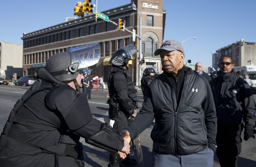 U.S. Rep. Elijah Cummings, D-Md., shakes hands with a Maryland State Trooper Tuesday, April 28, 2015, in the aftermath of rioting following Monday's funeral for Freddie Gray, who died in police custody. (AP Photo/Matt Rourke) ** FILE **