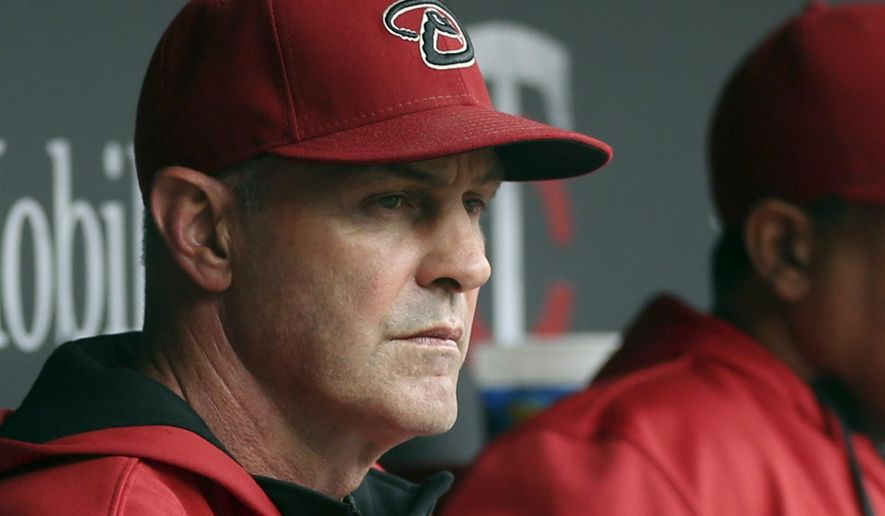 FILE - In this Sept. 24, 2014, file photo, Arizona Diamondbacks manager Kirk Gibson watches from the dugout during a baseball game against the Minnesota Twins in Minneapolis. Gibson says he has been diagnosed with Parkinson's disease. The 1988 National League MVP made the announcement Tuesday, April 28, 2015, through Fox Sports Detroit, where he calls Tigers games. (AP Photo/Jim Mone, File)
