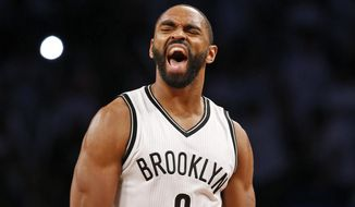 Brooklyn Nets guard Alan Anderson (6) reacts after making a basket in the second half of Game 4 of a first round NBA playoff basketball game against the Atlanta Hawks, Monday, April 27, 2015, in New York. The Nets defeated the Hawks 120-115 in overtime to even their series at 2-2. (AP Photo/Kathy Willens)