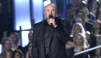 In a Sunday, April 19, 2015 file photo, Dr. Phil McGraw speaks on stage at the 50th annual Academy of Country Music Awards at AT&T Stadium, in Arlington, Texas.  (Photo by Chris Pizzello/Invision/AP, File)