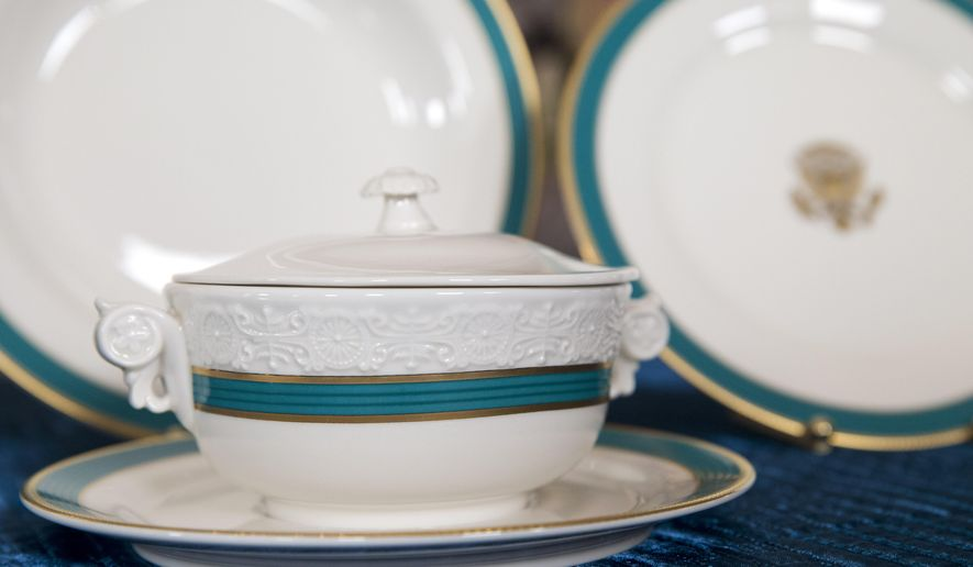 """An individual tureen that can be used for soup or dessert, part of the new Obama state china service, feature a fluted band of """"Kailua Blue"""" framed by a textured gold rim, is seen during a preview ahead of Tuesday's State Dinner hosted by President Barack Obama for Japanese Prime Minister Shinzo Abe, Monday, April 27, 2015, in the State Dining Room of the White House in Washington. (AP Photo/Jacquelyn Martin)"""