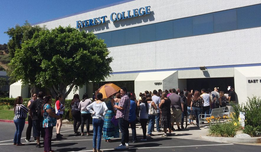 Students wait outside Everest College, Tuesday, April, 28, 2015 in Industry, Calif., hoping to get their transcriptions and information on loan forgiveness and transferring credits to other schools. Corinthian Colleges shut down all of its remaining 28 ground campuses on Monday, April 27, displacing 16,000 students. The shutdown comes less than two weeks after the U.S. Department of Education announcing it was fining the for-profit institution $30 million for misrepresentation. (AP Photo/Christine Armario)