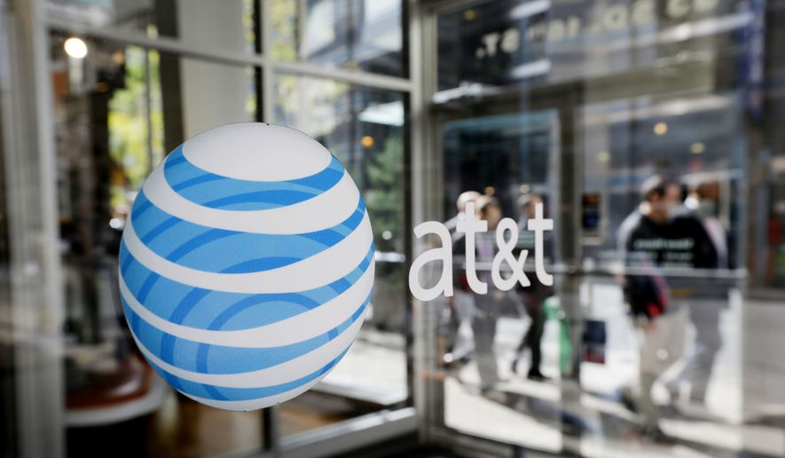 "In this Wednesday, Oct. 17, 2012, file photo, an AT&T logo is displayed on an AT&T Wireless retail store front, in Philadelphia. (AP Photo/Matt Rourke)"" ** FILE **"